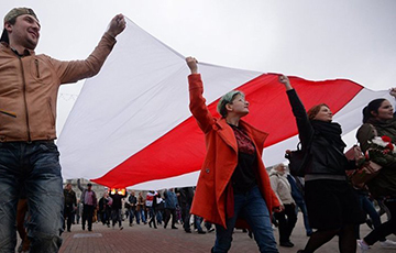 Two Large White-Red-White Flags Hung on One of the Houses in Minsk