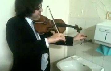 Дуэт скрипача с краном стал хитом Сети