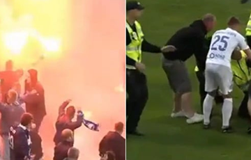 Видеофакт: Фанаты минского «Динамо» выбежали на поле в Латвии и подрались со стюардами