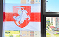 Photo Fact: Belarusians Hanging White-Red-White Flags On Their Windows