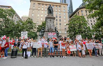 Белорусы Монреаля вышли на акцию протеста с национальными флагами