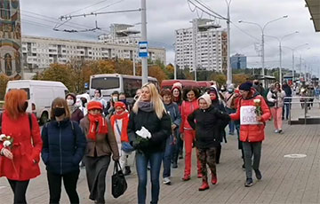 Column Of Women Walking Along Independence Avenue To Minsk Center