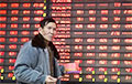 China Stocks Plunge to 13-Month Low Amid Capital Outflow Concern